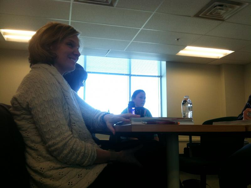 Hannah Mariotti listens during a training session for the educational surrogate program.