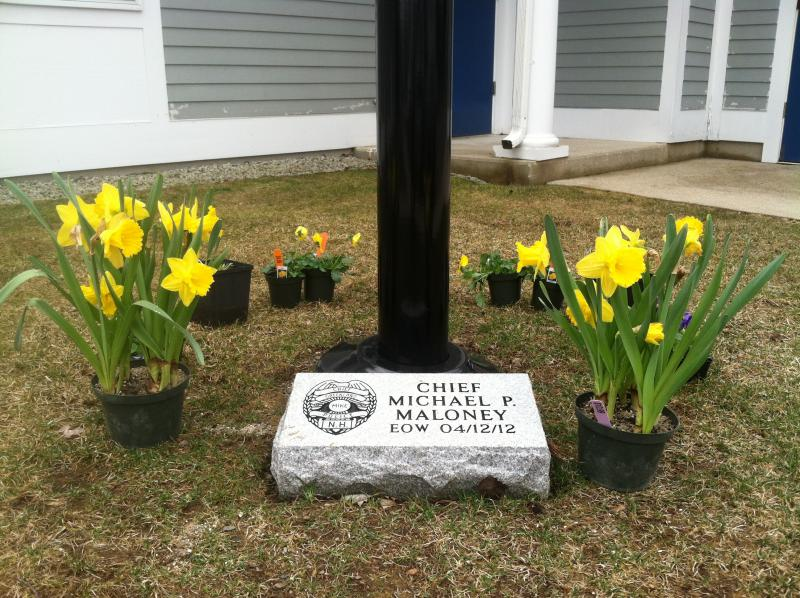 The memorial for Chief Michael Maloney outside the Greenland Police Department.