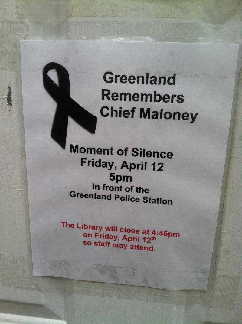 A poster outside the Weeks Public Library in Greenland announced the ceremony taking place Friday.