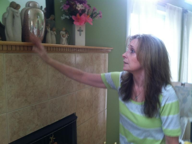 Donna Tibbetts keeps her daughter Brittany's urn on the mantle.