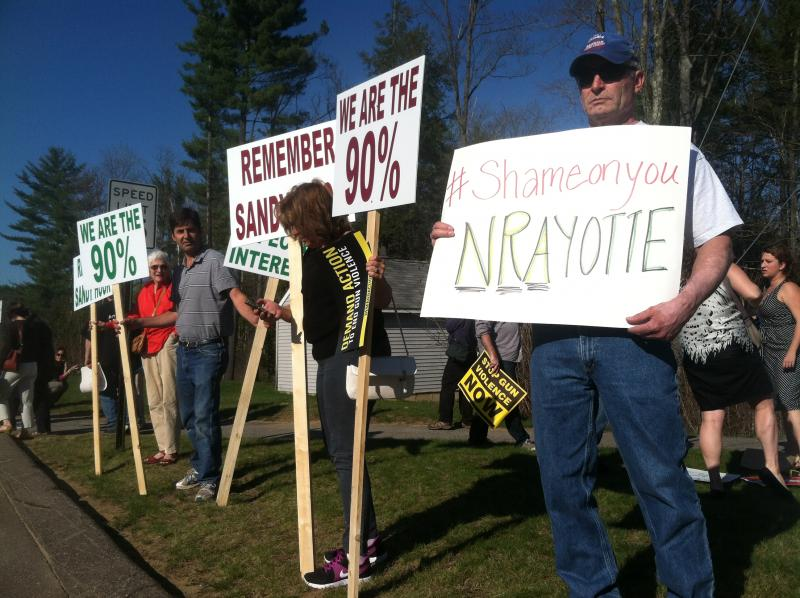 Critics of Sen. Ayotte's vote picket across the street from supporters at a town hall in Tilton on Tuesday.
