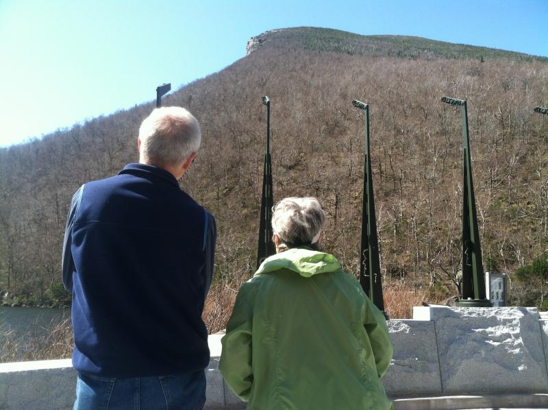 Bob and Phyllis Grigg of Edgecomb, Maine try to see the image of the Old Man through the profile viewers.