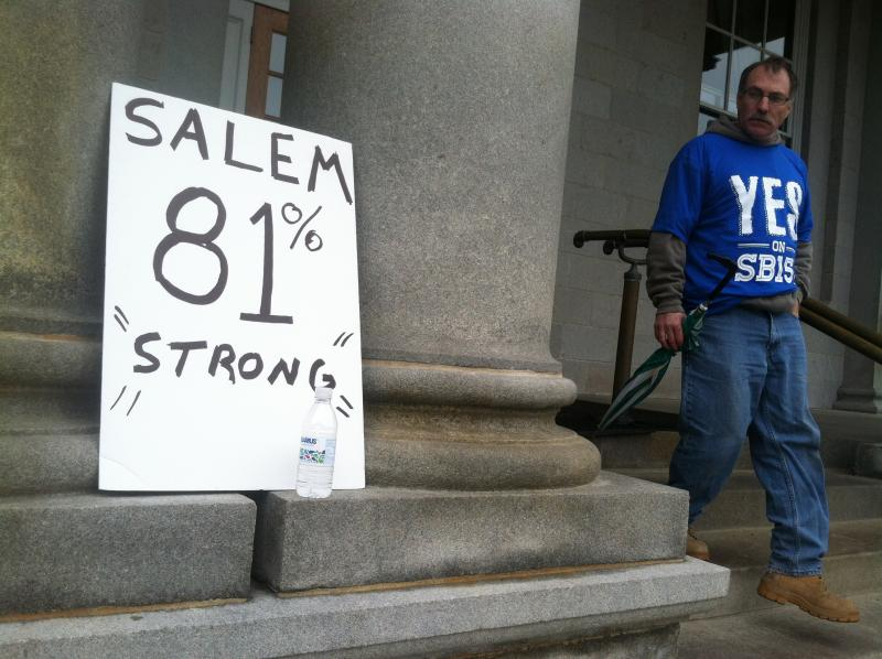 A supporter of SB 152, a bill legalizing a casino, walks out of the Statehouse Wednesday morning.