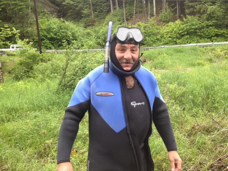 Arthur gets his wetsuit on