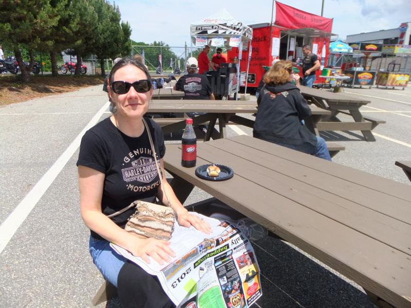 Jean Kugler, of Milwaukee, enjoyed a hot dog, soft drink and sunshine at the Loudon Race Track on Friday afternoon during the 90th Motorcyle Week.