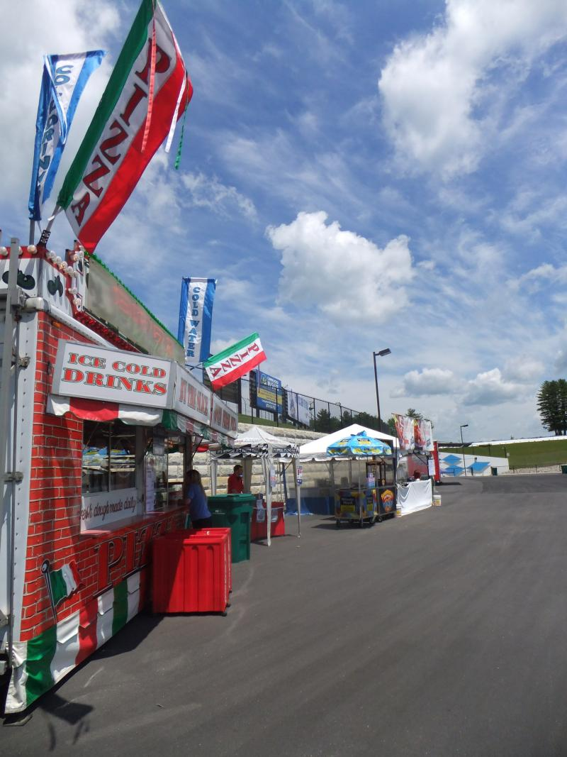 Vendors set up shop at the Loudon Race Track on Friday afternoon.