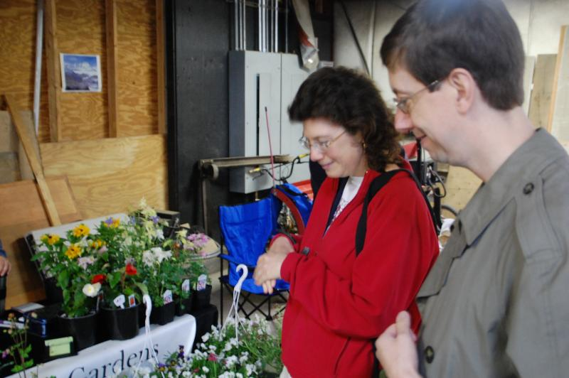 Beth & Tod Salerno choose vegetables at the Contoocook Winter Farmers Market