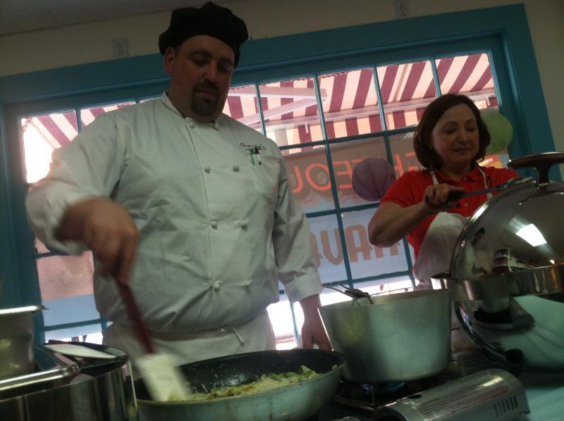 Inside Lisa's Sweets, Chef Dan St. Jean of Giorgio's Restaurant cooks up some asparagus and artichoke ravioli.