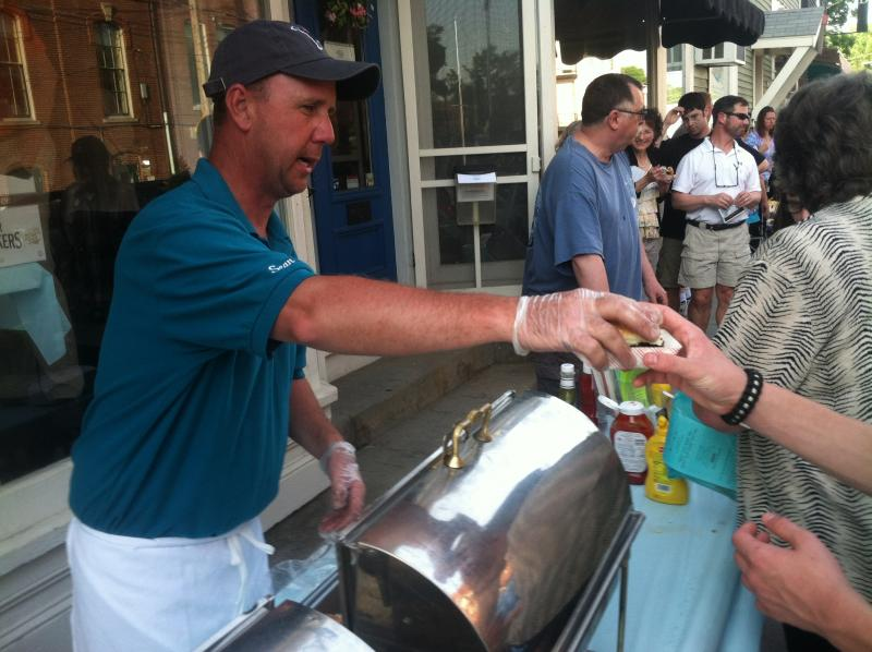 Sean Trombly of Trombly Gardens in Milford hands out a grass-fed beef slider.