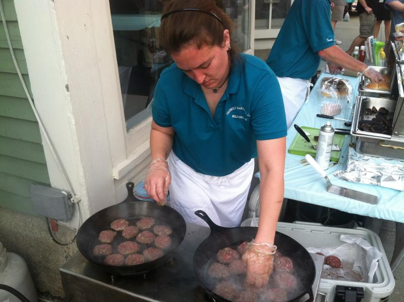 Vicki Riendeau of Trombly Gardens cooks up the grass-fed beef sliders at the Taste of Milford.