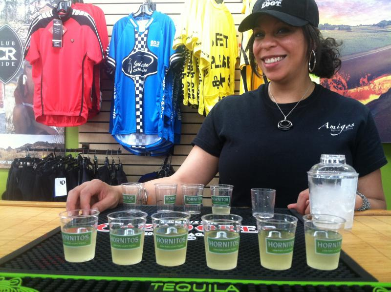 Becky Cox from Amigos Mexican Cantina serves up samples of their house margarita inside Souhegan Cycleworks.