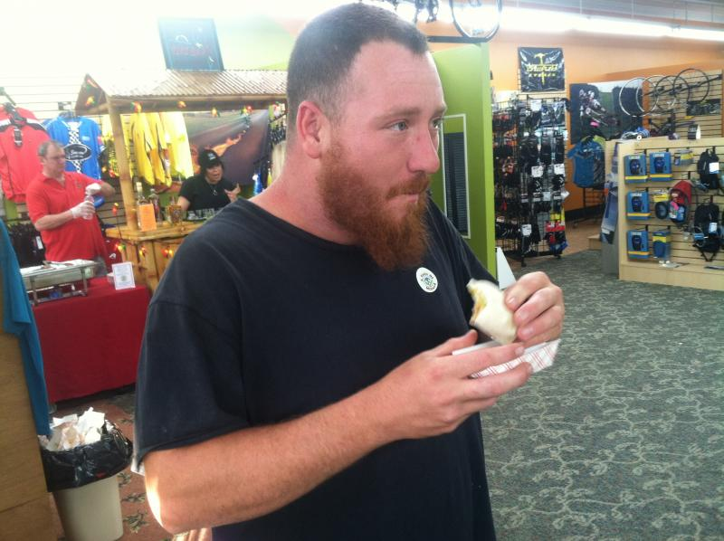 Dan Osborne of Lyndeborough samples a taco from Amigos Mexican Cantina.