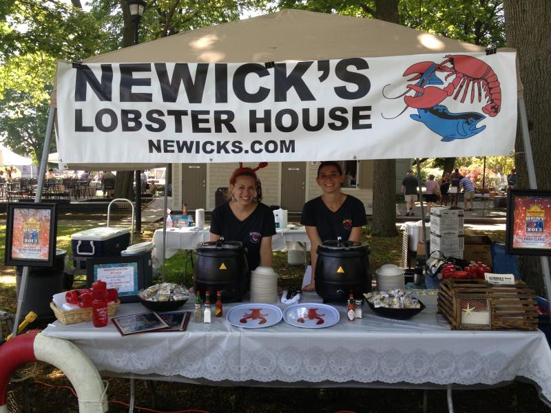 Two Newick's Lobster House Chowder employees at their booth at the WOKQ Chowder Festival in Prescott Park.