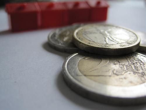 Euro coins and houses