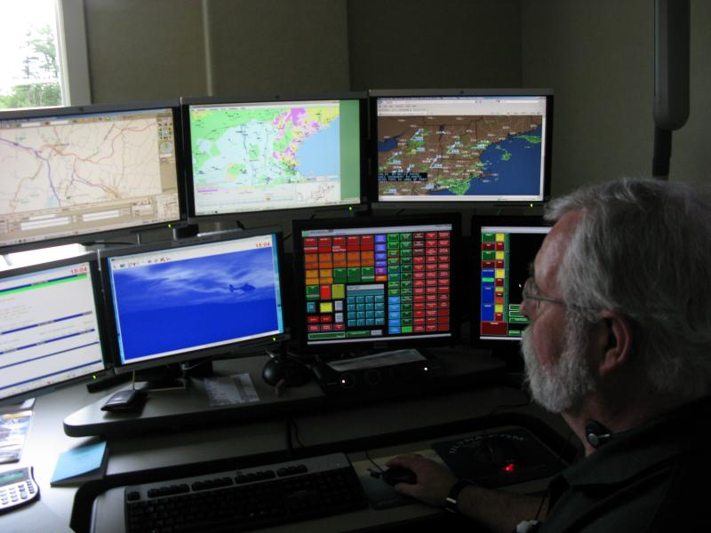 Mark Pippy scans the monitors inside of DHART's communications center. New England's ever-changing weather is his biggest battle.