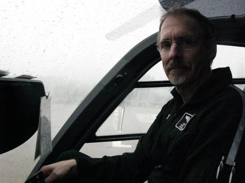Doug Moore gives a tour of the cockpit while a storm rolls through. He's one of nine full-time pilots.