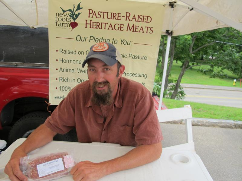 Jeff Cantara raises livestock at New Roots Farm in Newmarket. He drives to Athol, MA, to get his animals butchered. Pictured here at the Portsmouth Farmers Market.