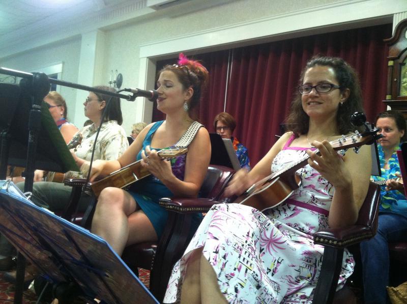 Kate Boisvert, left, sings as the Ukeladies perform a song at the Hanover Hill nursing home in Manchester.