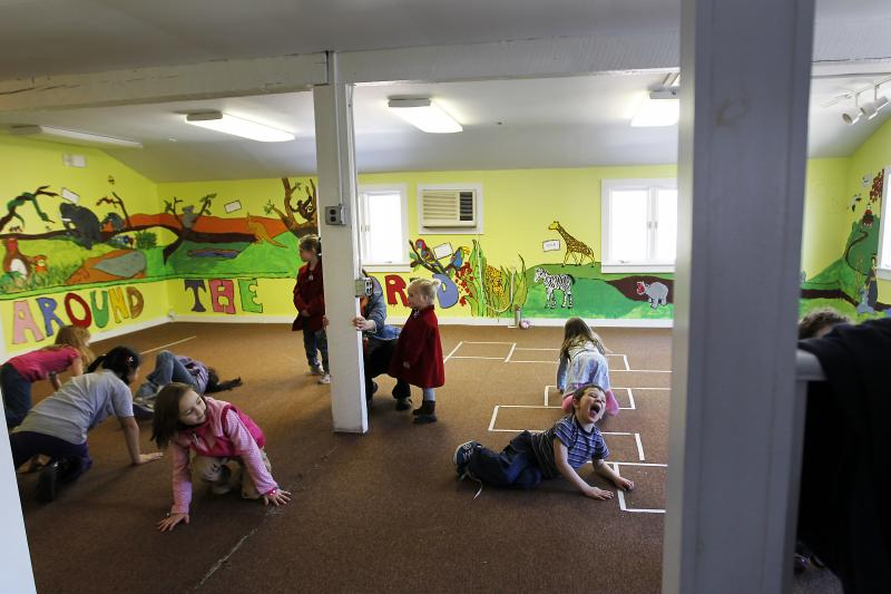 Children pretend to be babies during a class in the educational center at the Winnipesaukee Playhouse in Meredith, N.H.