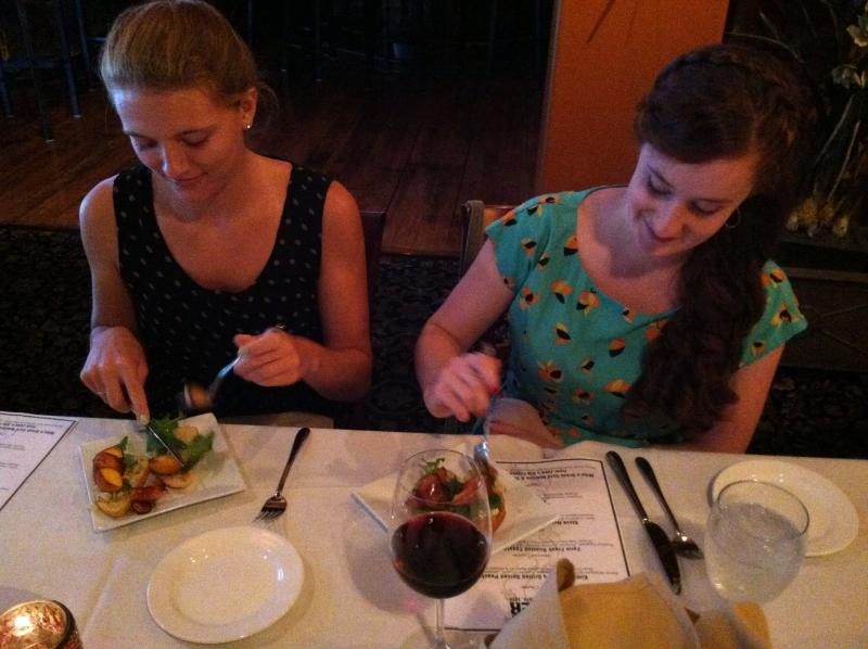 Jillian Towne, left, and Erin Gleason, right, enjoy the first course of the Farmers Dinner.