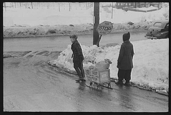 Children of paper mill workers bringing home groceries. Berlin, New Hampshire. The town is largely inhabited by French Canadians  and Scandinavians.