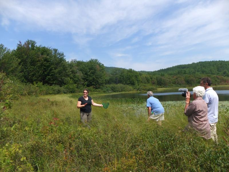 People listen, ask questions and search for wildlife at Bog Pond in Andover.