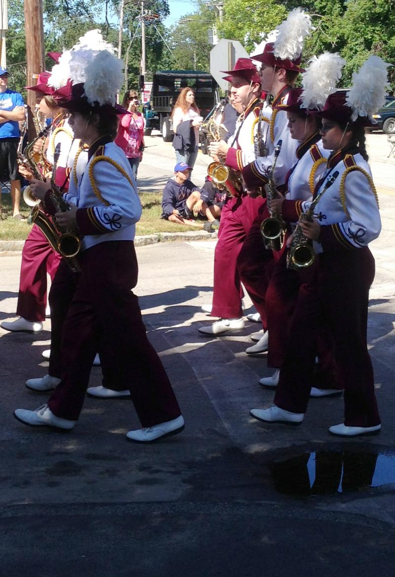 Alvirne High School's marching band heads for their busses at the end of the parade route.