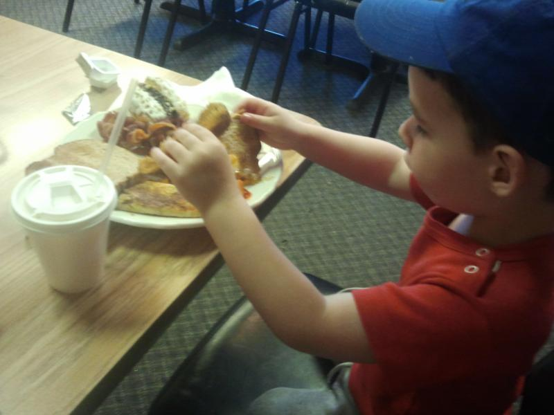 Two year old foodie Owen Carlson tries the breakfast buffet at the Friends Diner in Allenstown.