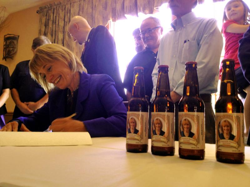 Governor Hassan signs HB 253 into law.