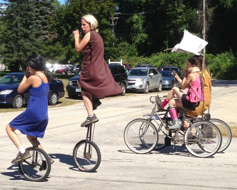 Multi-talented flautists play the flute while riding unicycles and a unique tandem bicycle in the parade.