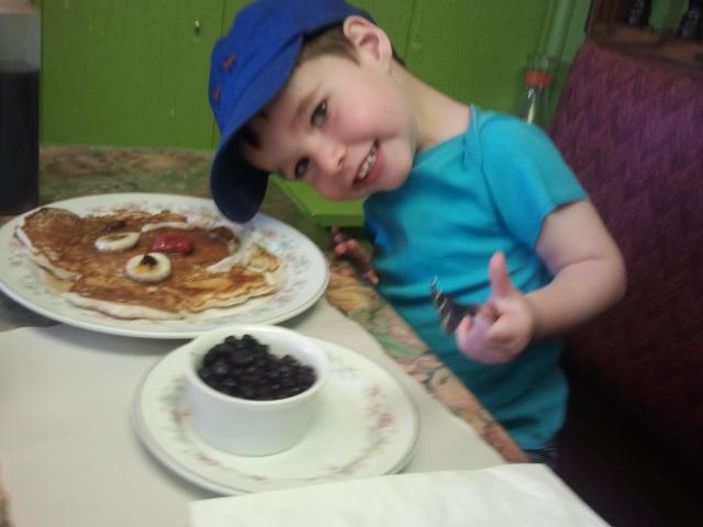 "Owen Carlson does his best impression of the smiling ""Special Kids Pancake"" at Julien's Corner Kitchen in Manchester."