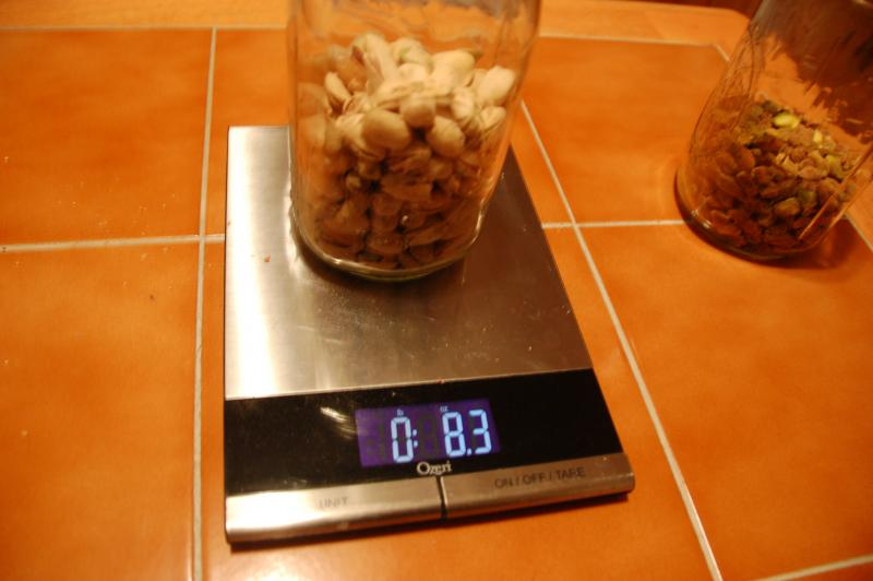 The pistachios with shells weighed in at 8.3 oz. .3 oz more than the package states.