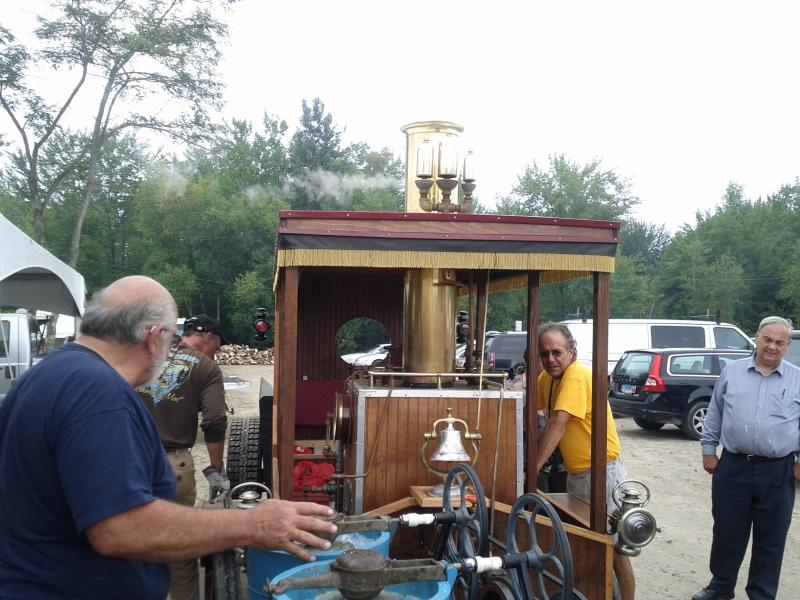 Clem from Delaware working on his ice cream. The steam truck engine was jury-rigged to the ice cream machine to provide the power.