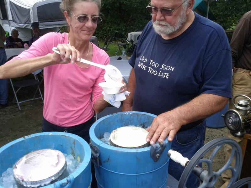 Clem Legates and wife scooping steam cream.