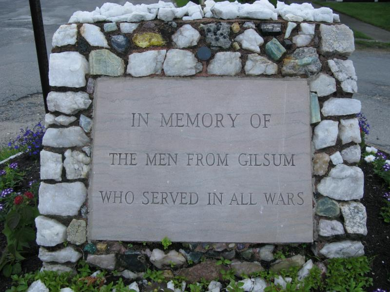 Gilsum War Memorial surrounded by minerals found in Gilsum