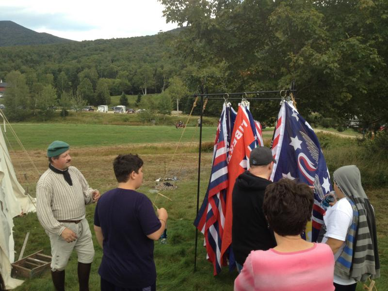 John Maxon describes the various flags he has for sale.