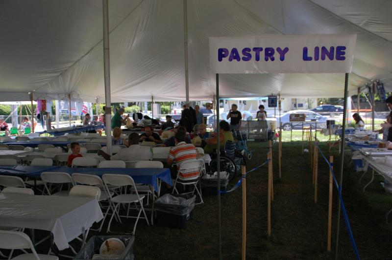The sign for the pastry line at the Greek Fest at Taxiarchai Orthodox Church in Laconia.
