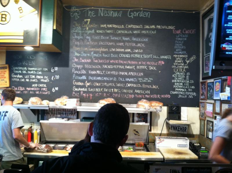 William Flynn chooses from among the sports-themed sandwiches at the Nashua Garden.