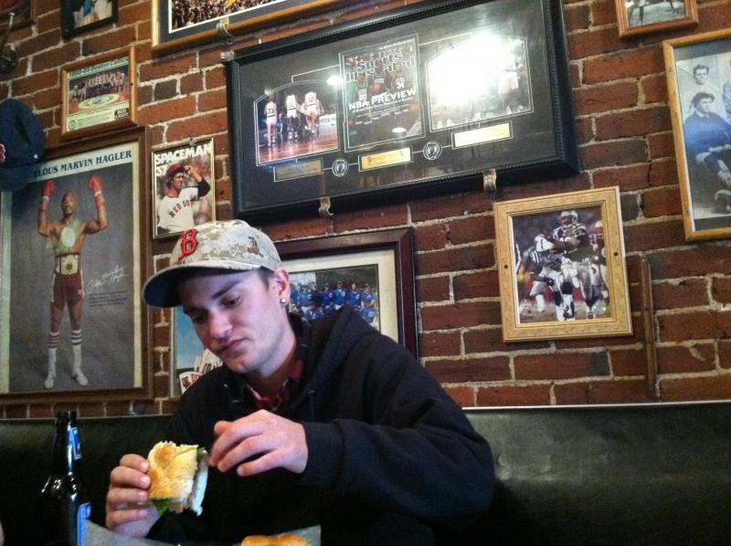 "Ryan Courtenay enjoys ""The Triple Play,"" which is roast beef, ham and turkey with American cheese."