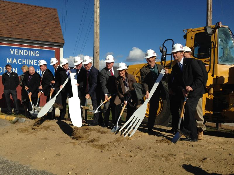Governor Hassan, DRED Commissioner Jeff Rose, DOT Commissioner Chris Clement, NHLC Chairman Joe Mollica, Common Man Restaurant owner Alex Ray and various lawmakers and counselors break ground.