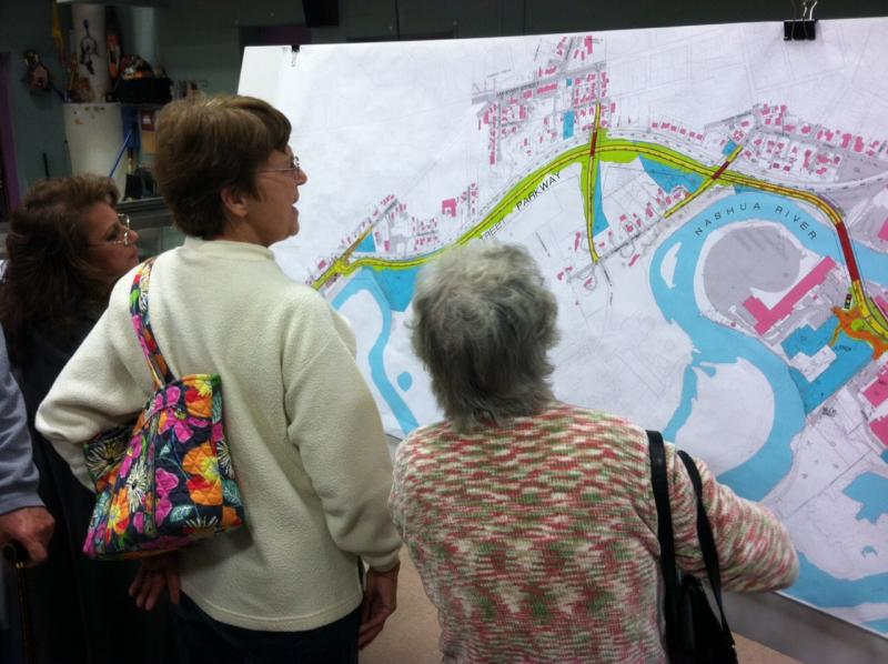 Residents look at a blueprint of the Broad Street Parkway at a community meeting at Amherst Street Elementary School on Monday.