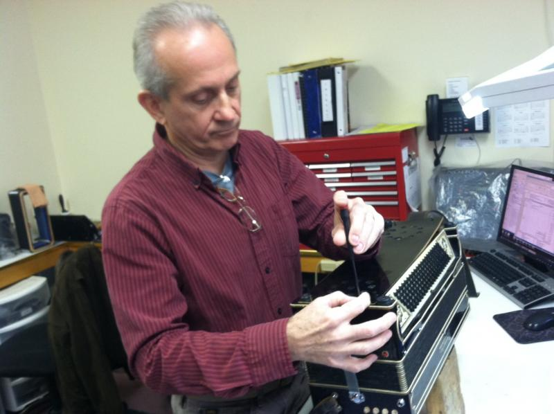 Peter Currier fixes accordions for the Accordion Connection in Gilmanton.