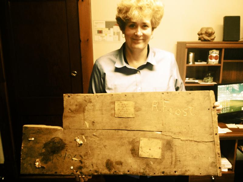 Maudelle Driskell holds the discovered crate top.