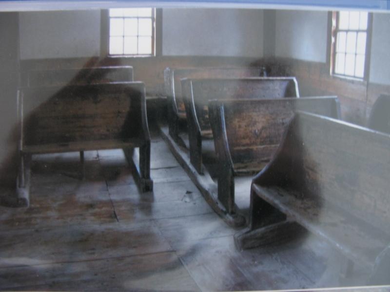 Original desks and chairs at the Old Candia Schoolhouse now at Old Sturbridge Village