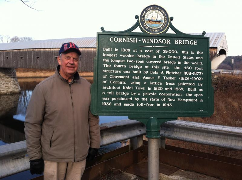 Stu Hodgeman stands in front of the Cornish-Windsor Covered Bridge
