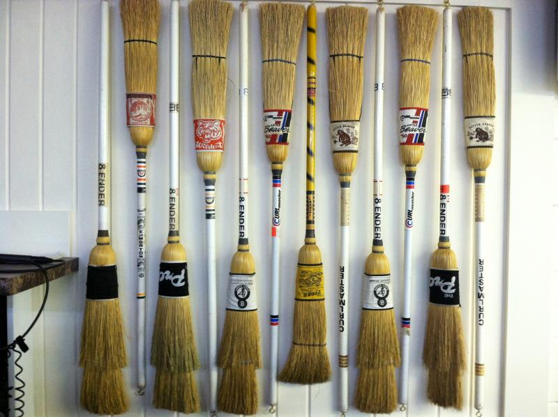 Brooms lined up against the wall inside the Nashua Country Club.