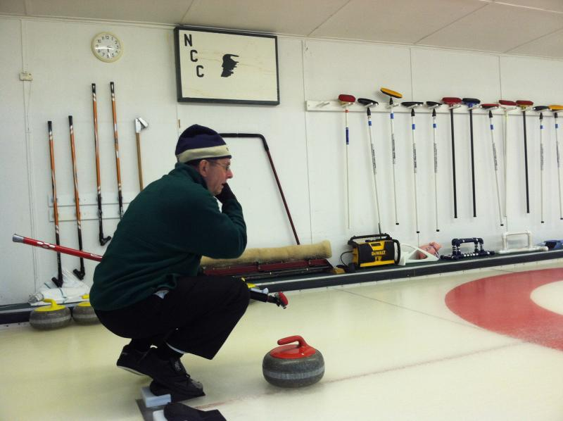 Leo Lambert prepares for his next move at the Christmas mixed bonspiel.