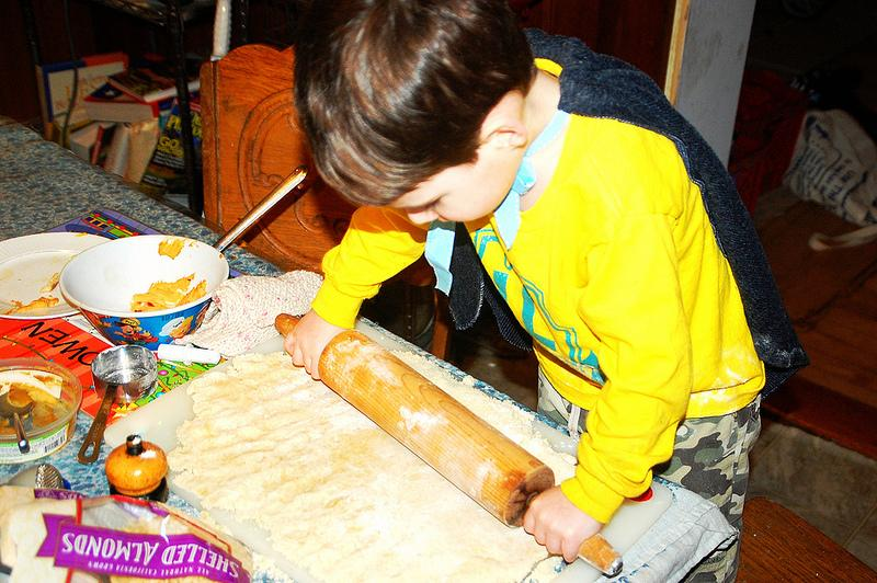 Owen Carlson rolls out the dough. This isn't technically in the recipe we're using, but rolling pins are fun.