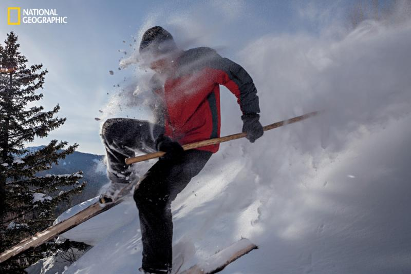 Blasting through powder on wooden, horsehide-bottomed skis with a single pole for balance, an Altay skier shows off the skills and equipment his distant ancestors perfected.
