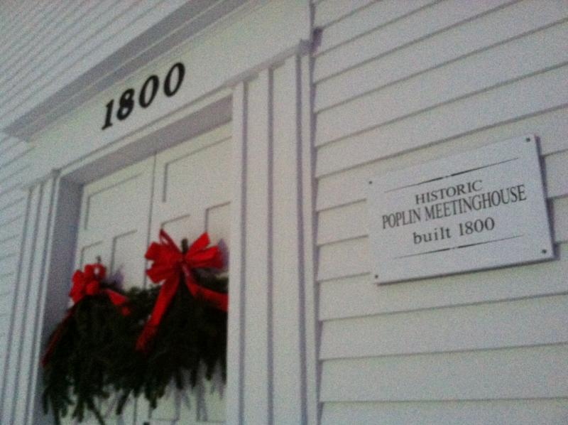 The town's original name, Poplin, is still on the front of the building.